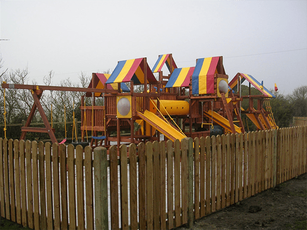 rainbow wooden climbingframe garden winter
